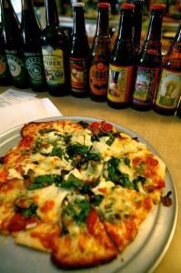 Pizza & Beer that can be purchased with ELMs at the Milkweed Mercantile